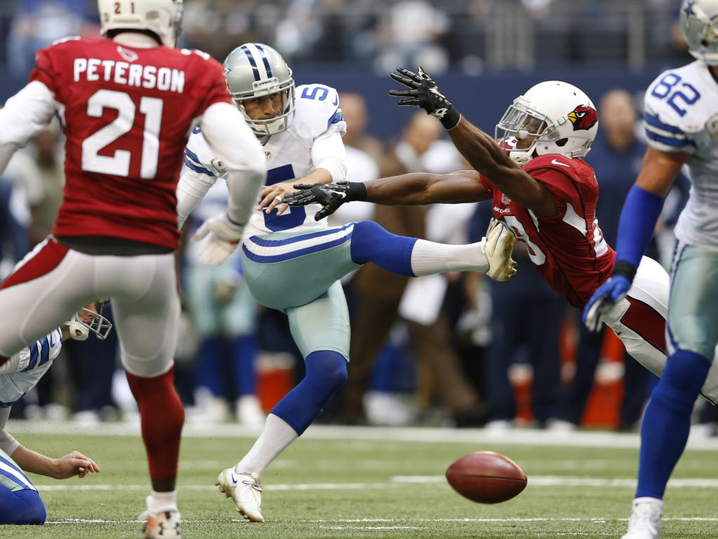 Arizona Cardinals cornerback Justin Bethel (28) blocks a field goal attempt from Dallas Cowboys kicker Dan Bailey (5) during the first half of play at AT&T Stadium in Arlington on Sunday, November 2, 2014. (Vernon Bryant/The Dallas Morning News)